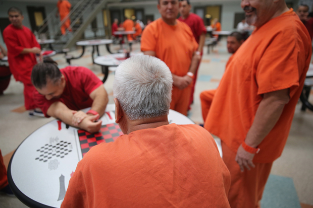 Detainees talk while in a general population block at the Adelanto Detention Facility on November 15, 2013 in Adelanto, California.